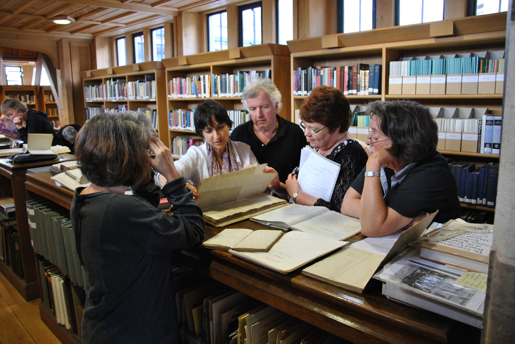 Darrelyn Gunzburg with MA Director, Nick Campion, and MA students viewing manuscripts in the Hereford Cathedral Library, MA Summer School, 2010.